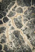 Cracked stone wall photo