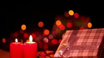 Gift Box and Candles on a Bokeh Background