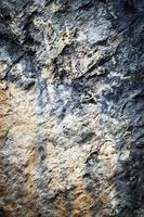Old dark limestone rock photo