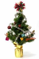 Christmas tree with colorful ornaments on a white background photo