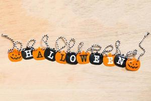 Halloween decoration, black and orange flags on a wooden background