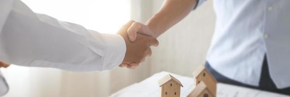 Successful agreement of estate, home buying contract concept photo