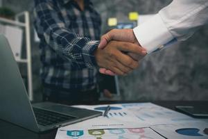 Successful negotiation and handshake concept, two businessmen shake hands photo