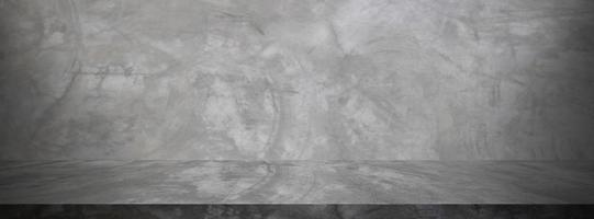 estudio de cemento negro y fondo oscuro de la sala de exposición foto