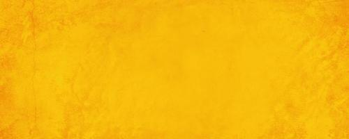 Horizontal yellow and orange texture cement wall background photo