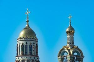 Two domes of the Temple of Prince Vladimir with a clear blue sky in Sochi, Russia