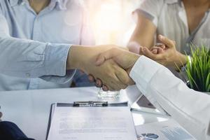Successful contract negotiation and cooperation in acquisition and merger photo