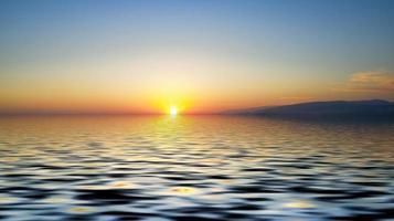 paisaje marino con colorido atardecer naranja, montañas y mar foto