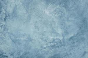 Blue cement wall with dark texture background photo