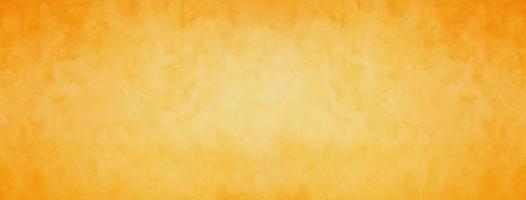 Orange and yellow grunge cement background photo
