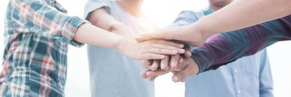Teamwork and brainstorming concept, hands of group together photo