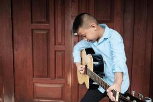 Boy playing a guitar photo