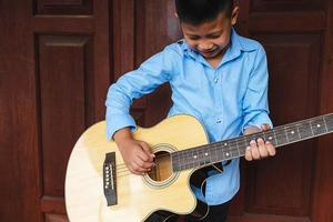 Kid playing a guitar