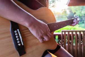 Person strumming a guitar photo