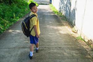 Boy walking to school photo