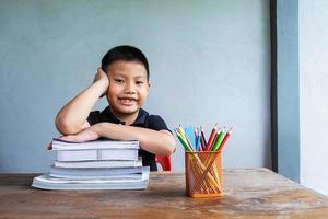 Boy posing at desk photo