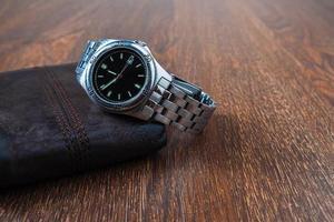 Wristwatch on a wallet photo