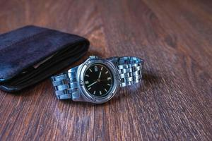 Wristwatch and a wallet photo