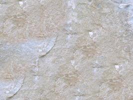 parte de la pared de piedra de fondo o textura foto