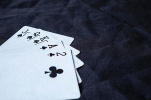Set of cards on a black cloth background photo