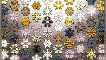 flocon de neige coloré 3d brillant avec des particules dorées