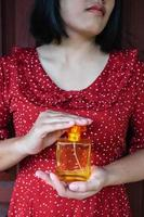 Woman holding a perfume bottle