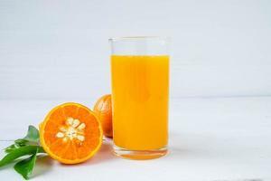 Fresh orange and orange juice on the table photo