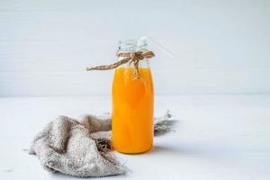 Jar of orange juice photo