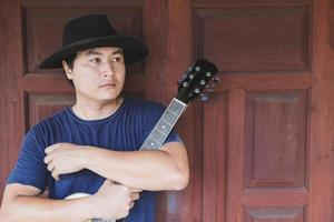 Man posing with a guitar