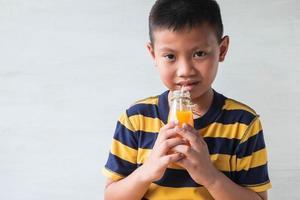 Boy drinking juice photo