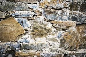Detalle de un antiguo muro de piedra foto
