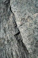 Crack on granite rock photo