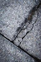 Cracked concrete pavement photo