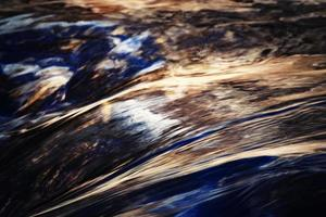 Detail of a blurred autumn river photo