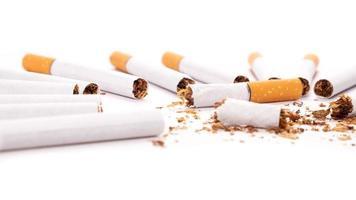 Broken cigarettes on a white background photo