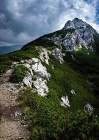 Mountain peak under clouds