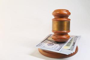 Gavel and cash on white background with copy space photo