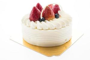 Vanilla cream cake with strawberry on top photo