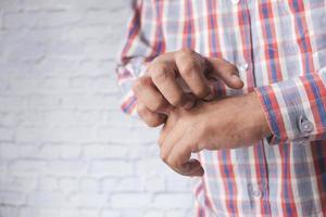 Man itching his skin photo