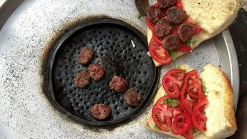 Turkish Meatball on Bread Sold in Street