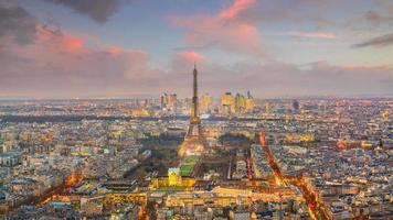 Skyline of Paris with Eiffel Tower at sunset in France photo