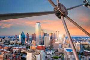 Dallas, Texas cityscape with blue sky at sunset photo