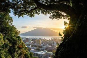 Kagoshima city downtown skyline cityscape  with Sakurajima Volcano in Kyushu, Japan photo