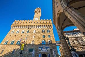 Palazzo Vecchio in Florence Italy with blue sky photo