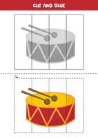 Cut and glue game for kids. Cartoon drum. vector