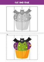 Cut and glue game for kids. Cute Halloween cupcake. vector
