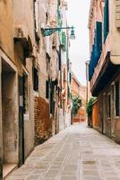 Tourist routes of the old Venice streets of Italy photo