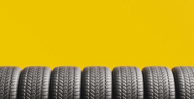 Yellow background with a row of tires