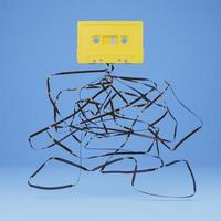 Old yellow cassette with the ribbon tangled underneath, 3D rendering photo