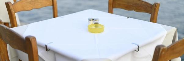 Cafe tables on the sea, selective focus photo